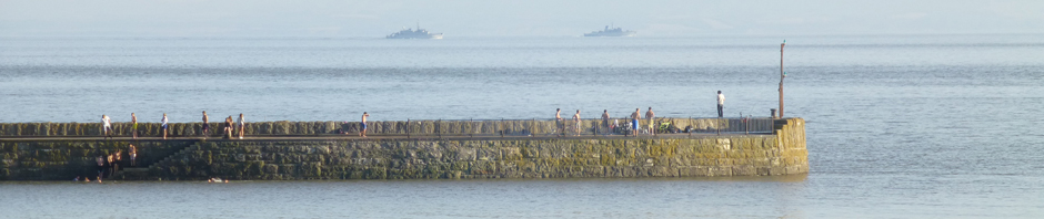 On another day the swimmers paused to watch two NATO boats sail away from the Cardiff summit.
